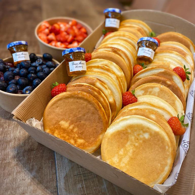 PANCAKE BOX – Buttermilk pancakes served with blueberry compote, honey & strawberries (price per person)